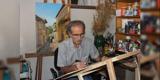 40 yılını verdiği ahşap yakma sanatıyla yöresini en güzel şekilde resmediyor