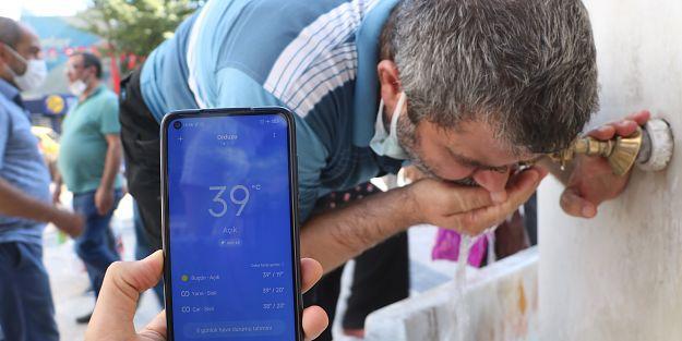 Sıcaktan bunalan vatandaşlar, çeşmelerde serinledi